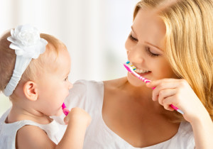 Mommy and Baby Brushing Teeth